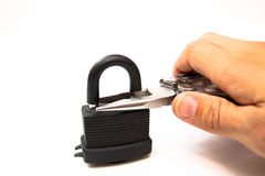 Man bites lock. The man with the help of pliers to break the lock Royalty Free Stock Photo