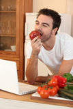 Man biting into an apple Royalty Free Stock Image