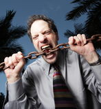 Man biting a chain Royalty Free Stock Photography