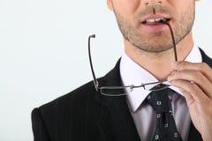 Man biting glasses Royalty Free Stock Images