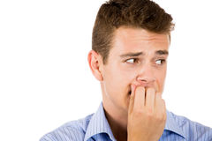 man biting his nails and looking to the side with a craving for something or anxious Royalty Free Stock Photos