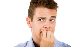 Man biting his nails and looking to the side with a craving for something or anxious. Closeup portrait of a man biting his nails and looking to the side with a Royalty Free Stock Image