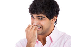 Man biting his nails stressed ands anxious, Stock Image