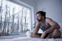Man biting his nails. Man suffering from sleeplessness biting his nails royalty free stock photos