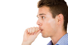 Man biting his thumb fingernail or finger in mouth Royalty Free Stock Images