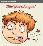 A man biting his tongue Stock Image