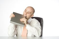 Man Biting Laptop Royalty Free Stock Photography