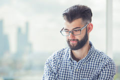 Man biting lip. Portrait of casual young man biting lip on blurry background Stock Photo