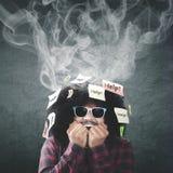Man biting nail with smoke over head Royalty Free Stock Photo