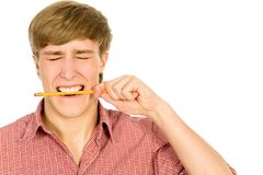 Man biting a pencil Stock Photo