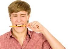 Man biting a pencil Stock Photo