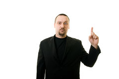Man in Black. Suit with a finger shows up Stock Photos