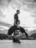Man with black angel woman on the rooftop Stock Images