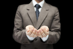 Man on black background with open hands. Stock Photo