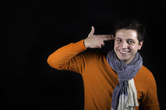 Man on black background posing and fooling. Royalty Free Stock Photo