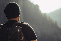 Man in Black Beanie and Black Shirt While Carrying Backpack during Daytime Royalty Free Stock Images
