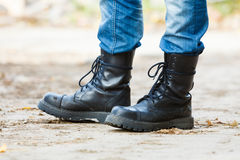 Man in black boots. Royalty Free Stock Photos