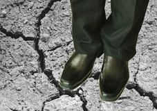 Man in black business pant and lather shoe on dirt ground. Man in black business pant and lather shoe on the dirt ground stock photos