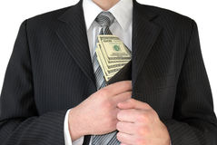 Man in black business suit, holding cash in hands Royalty Free Stock Photos
