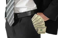 Man in black business suit, holding cash in hands Stock Photo