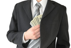 Man in black business suit, holding cash in hands Stock Image