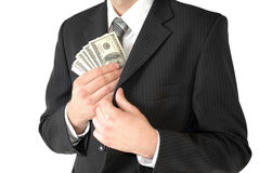 Man in black business suit, holding cash in hands Stock Photography