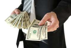 Man in black business suit, holding cash in hands Royalty Free Stock Photo