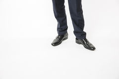 Man in black business suit and tidy shoes, copy space. Man in black business suit and tidy shoes standing on white background. Business success concept, copy Stock Images