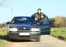 Man in black by a car Royalty Free Stock Photography