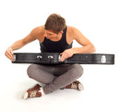 Man with black case on guitar Stock Image