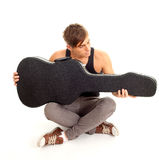 Man with black case on guitar Stock Images
