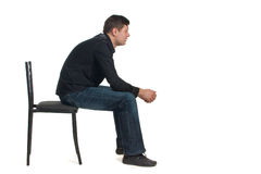 Man on black chair. Stock Photos
