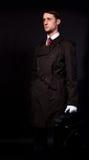 Man in a black cloak Stock Image