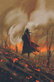 Man in black cloak standing against burning forest royalty free illustration
