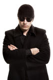 Man in black coat and sunglasses Royalty Free Stock Photos