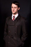 Man in a black coat and tie. Young man in a black coat and tie Royalty Free Stock Photography
