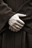 Man in black with crossed hands. Man with black robe with crossed hands royalty free stock images