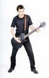 Man with a black electric guitar Stock Photos