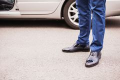 A man in black elegant shoes. Against the background of the car. Stylish clothes Stock Photography