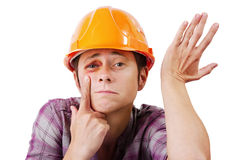 Man with a black eye in an orange helmet Royalty Free Stock Photography
