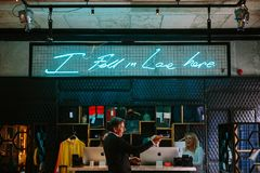 Man in Black Formal Suit Jacket Standing Near Girl and I Fall in Love Here Neon Signage Stock Photos