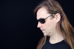 Hippies with long hair. A man is in black glasses Royalty Free Stock Images