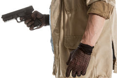 Man in black gloves with a gun Stock Photos