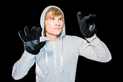 Man with black gloves hitting glass Stock Photography