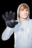 Man with black gloves staring at camera Royalty Free Stock Image