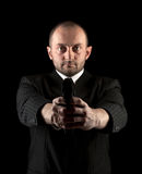 Man in black with gun Stock Images