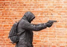 Man in black with gun Stock Image