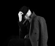 Man in black hat and coat Stock Photos