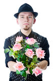 Man in black hat with flowers Stock Images