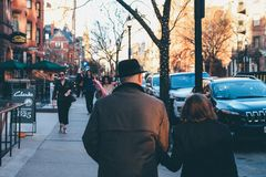 Man in Black Hat Holding His Wife stock photo
